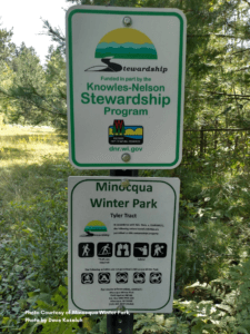 Sign displaying the Knowles-Nelson Stewardship Program logo, which shows that the property in question received Knowles-Nelson funding