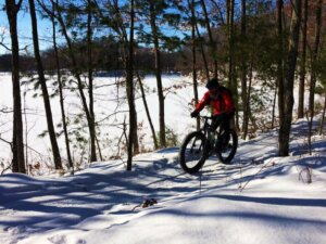 A person rides a fat bike on the Hickory Ridge Trails, which are funded in part by the Knowles-Nelson Stewardship Program.