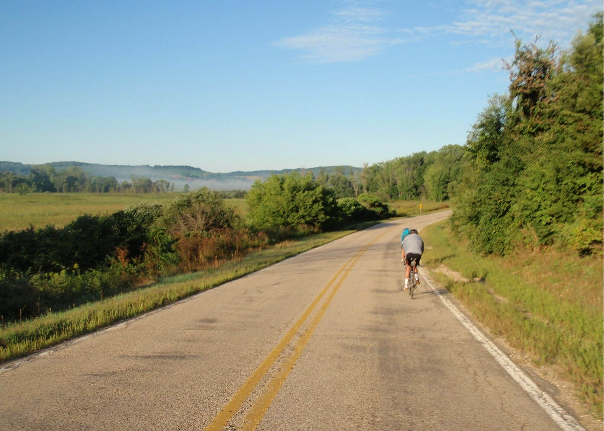 Biking along the road in Dane County, where a bike/pedestrian trail will be expanded thanks to Knowles-Nelson.