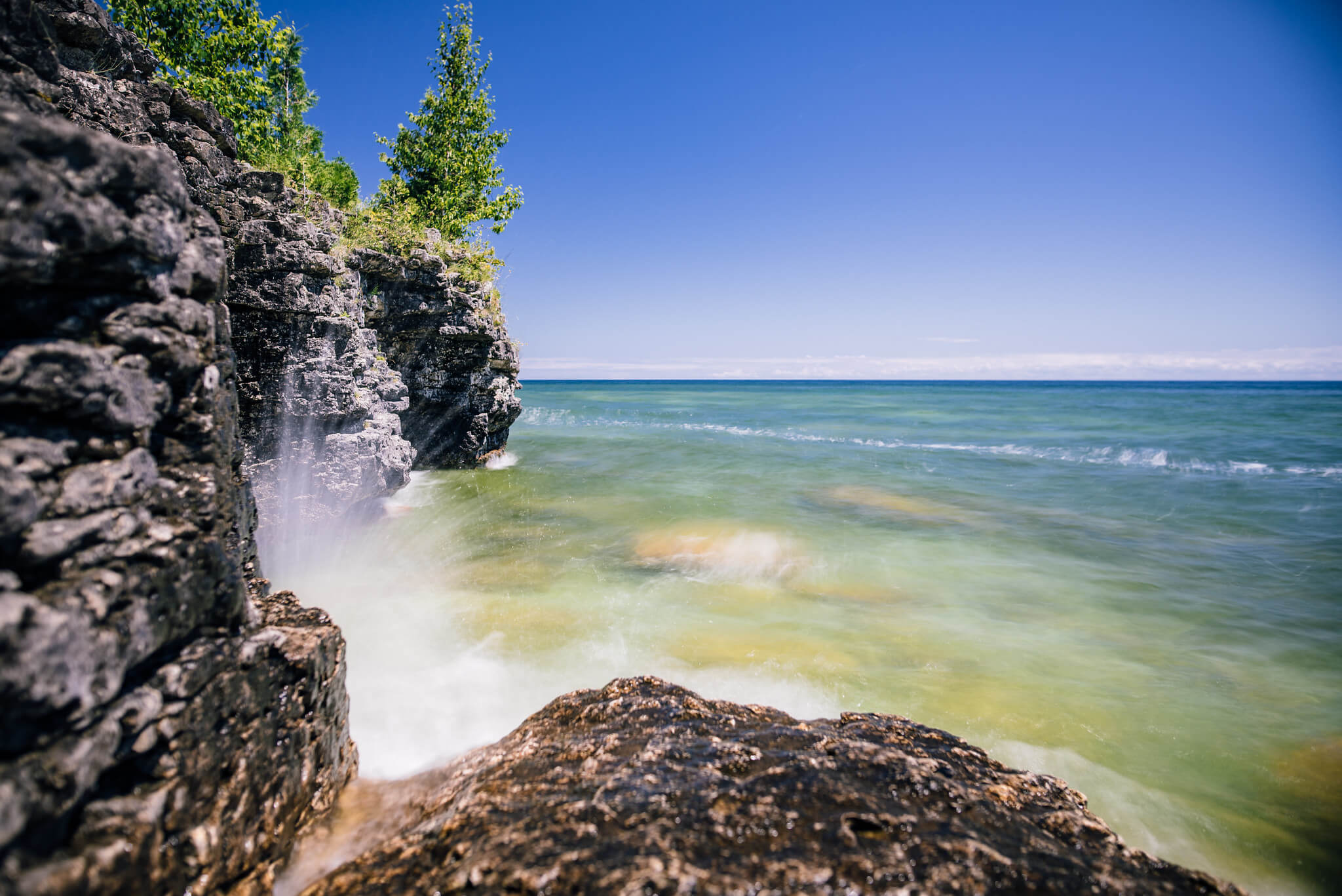 Wave hitting the rock in Door County, where the Knowles-Nelson Stewardship has had a huge impact on conserved lands.