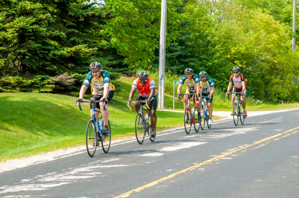 Cyclists on a trail. Vilas County has created many bike trails thanks to Knowles-Nelson.